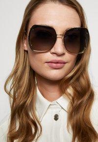 Salvatore Ferragamo - Sunglasses - gold-coloured/grey gradient flash - 1