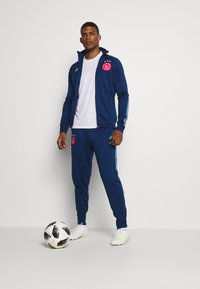 adidas Performance - AJAX AMSTERDAM AEROREADY FOOTBALL TRACKSUIT - Club wear - blue - 1