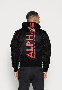 Alpha Industries - TEC BACKPRINT EXCLUSIV - Bomber Jacket - black/red - 2