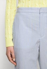 Polo Ralph Lauren - SEERSUCKER - Trousers - blue/white - 6