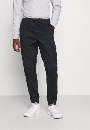 JIM CUFF - Cargo trousers - black