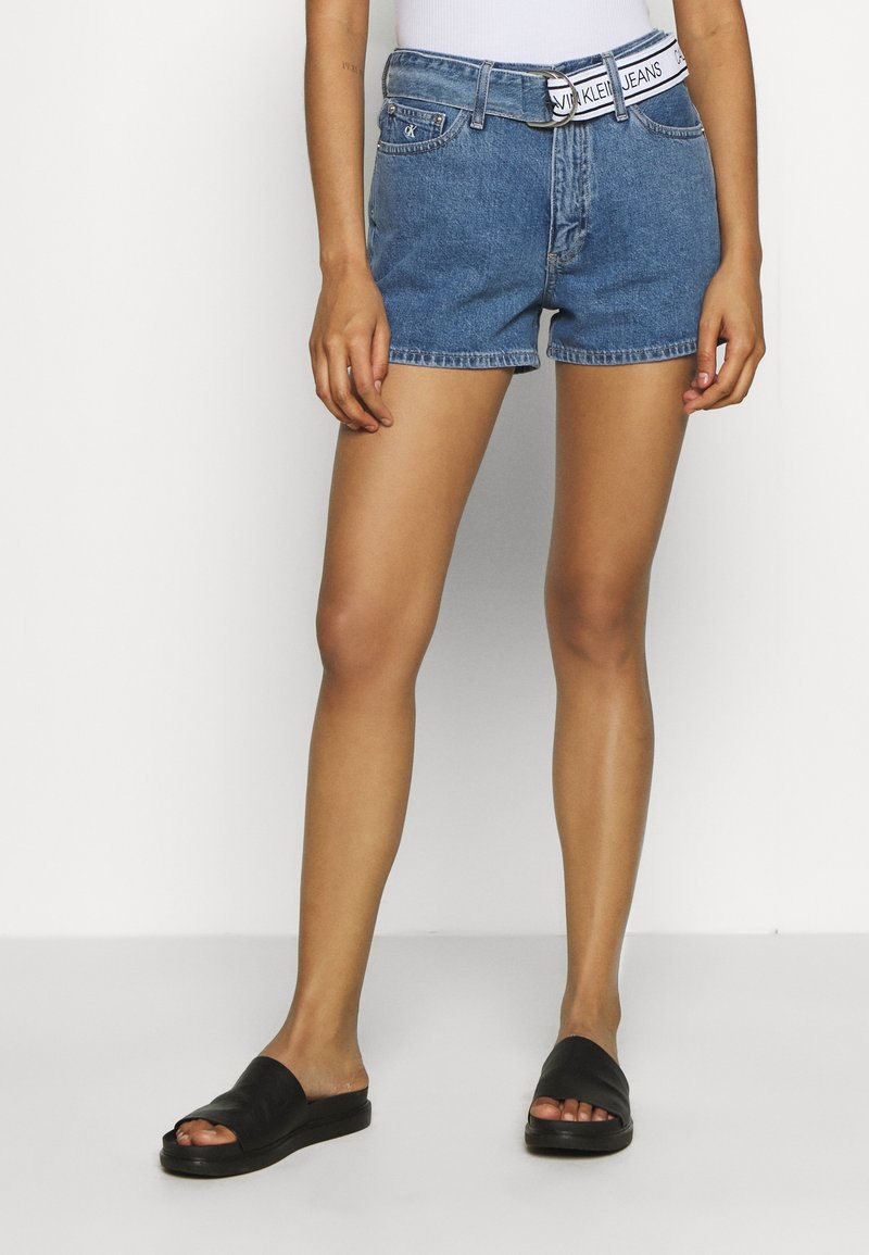 Calvin Klein Jeans - HIGH RISE - Denim shorts - light blue