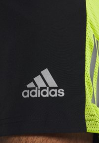 adidas Performance - OWN THE RUN - Sports shorts - black/signal green - 3