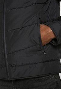 Calvin Klein - QUILTED JACKET - Light jacket - black - 5