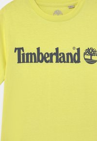 Timberland - SHORT SLEEVES - Print T-shirt - citrine - 2