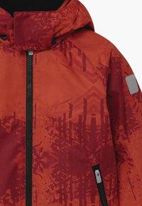 Reima - WINTER MAUNU UNISEX - Zimní bunda - lingonberry red - 3