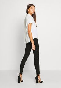 Noisy May - NMMEDLEY SLIM PANT - Legginsy - black - 2