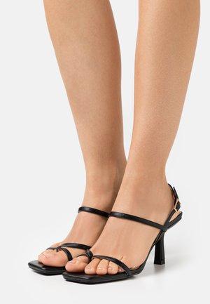 SAWYER - T-bar sandals - black