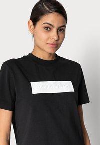 Calvin Klein Jeans - HERO LOGO DRESS - Jersey dress - black - 4