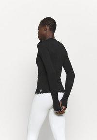 Free People - SOLID HIGH JUMP - Maglietta a manica lunga - black - 2