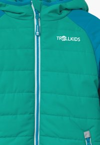 TrollKids - HAFJELL SNOW PRO UNISEX - Lyžařská bunda - light petrol / dark mint / white - 5