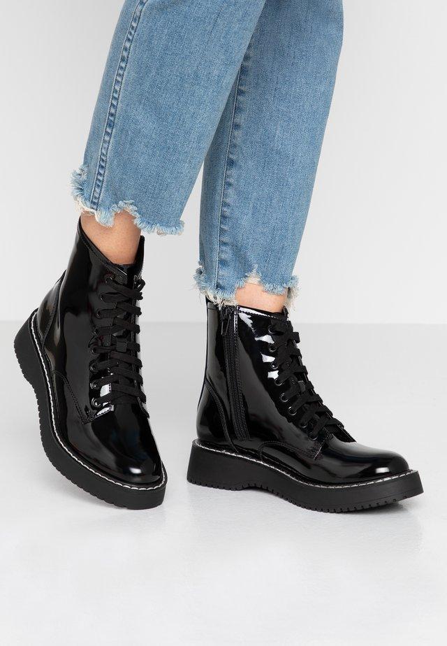 KURRT - Kotníkové boty na platformě - black