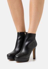 ALDO - DWENADIA - Platform ankle boots - black - 0