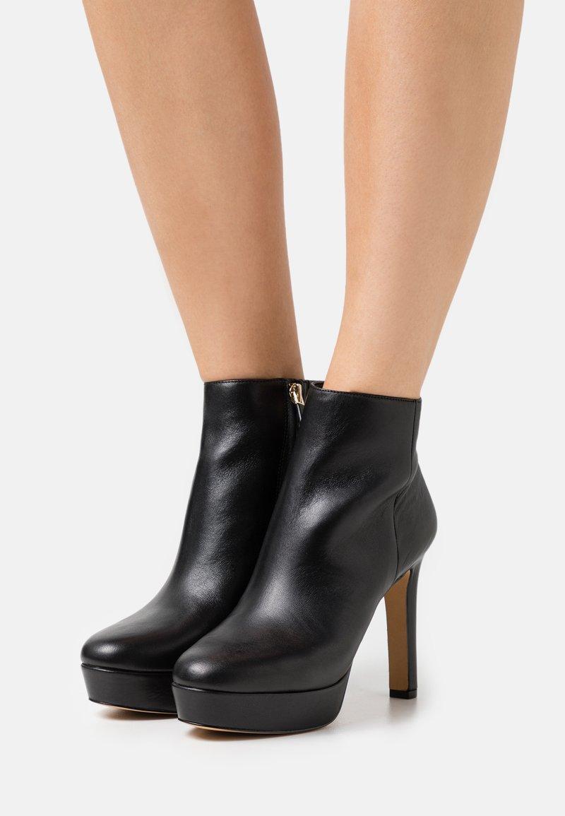 ALDO - DWENADIA - Platform ankle boots - black