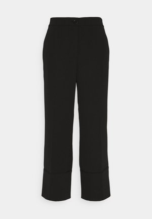 CHULI - Trousers - black