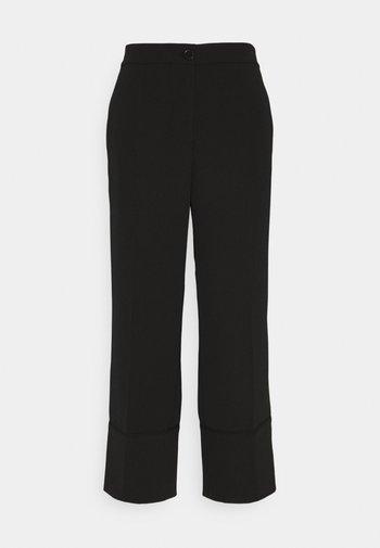 CHULI - Trousers - black