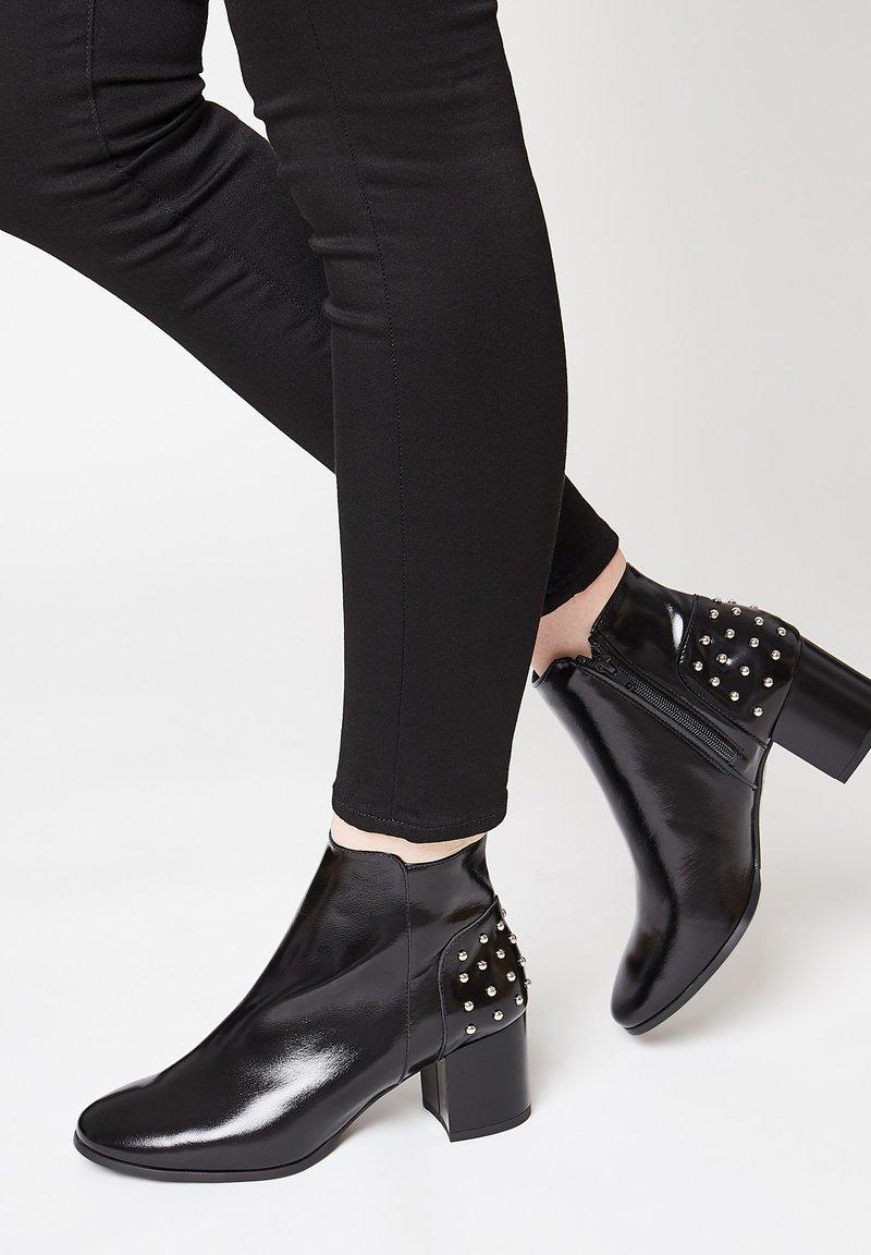 faina - Classic ankle boots - schwarz