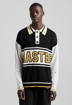MIT RISSEN UND SLOGAN - Polo shirt - black