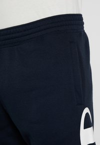 Champion - CUFF PANTS - Verryttelyhousut - dark blue