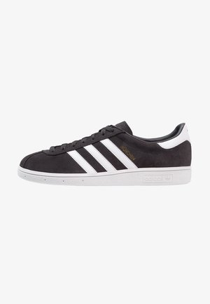 MÜNCHEN - Trainers - carbon/footwear white/gold metallic