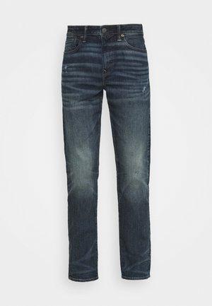 DARK BULLET HOLES - Straight leg jeans - deep indigo