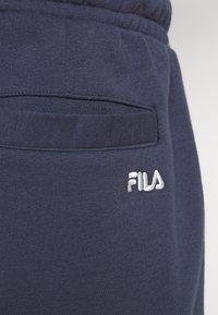 Fila - NOLAN SHORTS CROPPED - Sports shorts - black iris - 5