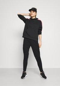 adidas Performance - Pantalones deportivos - black/white - 1