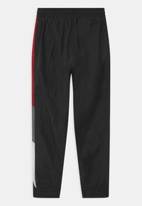 Jordan - JUMPMAN WAVE WIND - Tracksuit bottoms - gym red - 1