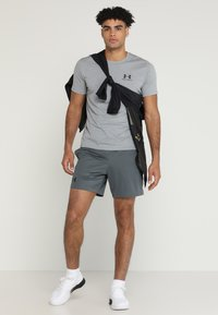 Under Armour - HEATGEAR RAID  - Sports shorts - pitch gray/black - 1