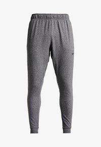 Nike Performance - M NK DRY PANT HPR DRY LT YOGA - Tracksuit bottoms - black - 4