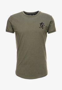 LONG LINE CURVE TEE - T-shirt print - burnt olive