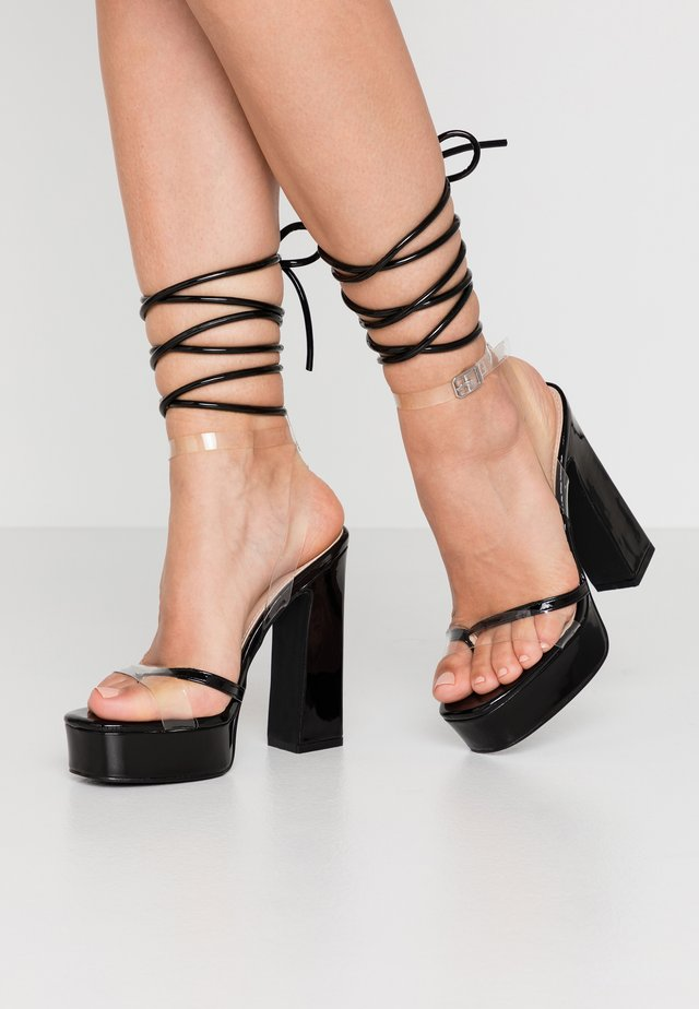ARYA - High heeled sandals - clear/black