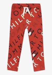 Tommy Hilfiger - SPORTS PRINTED LOGO  - Teplákové kalhoty - red - 0