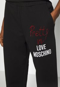 Love Moschino - Tracksuit bottoms - black - 4