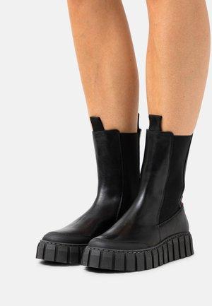 SUNDAY - Platform ankle boots - black