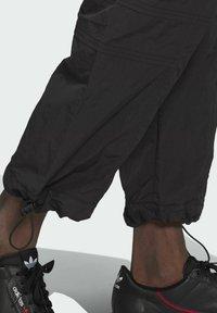 adidas Originals - ADV Woven PANTS ADVENTURE ORIGINALS REGULAR TRACK - Tracksuit bottoms - black - 4