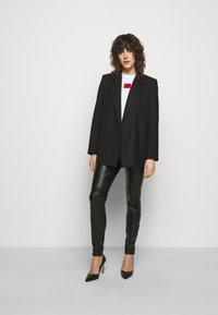 HUGO - HONATI - Leggings - Trousers - black - 1