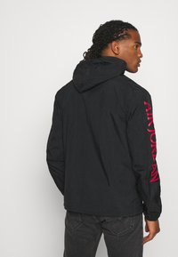 Jordan - JUMPMAN - Summer jacket - black/white - 2