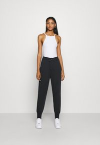 Nike Sportswear - Jogginghose - black/black - 1