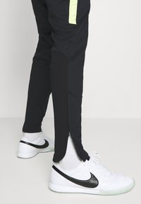 Nike Performance - ACADEMY PANT WINTERIZED - Tracksuit bottoms - black/volt - 3