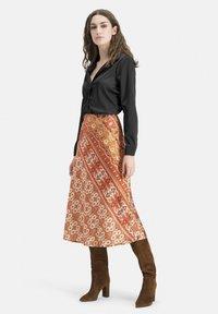 Nicowa - EXTRAVAGANTER MIT ETHNO-MUSTER - SLIWA - A-line skirt - orange - 1