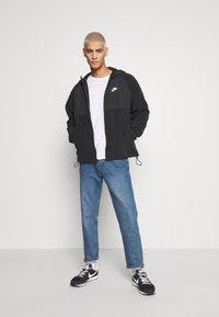 Nike Sportswear - HOODIE WINTER - Fleece jacket - black/white - 1