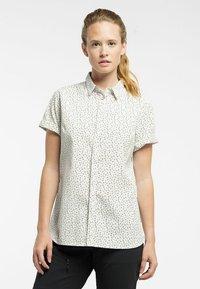 Haglöfs - IDUN SS SHIRT - Button-down blouse - soft white flower - 0