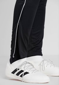adidas Performance - CORE - Tracksuit bottoms - black/white - 4