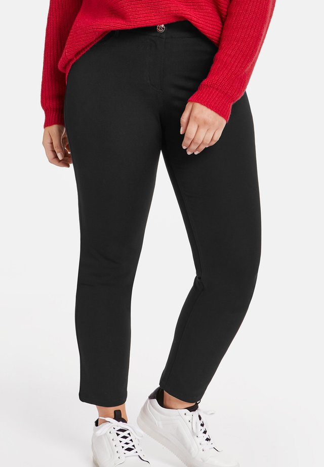 BETTY  - Trousers - black