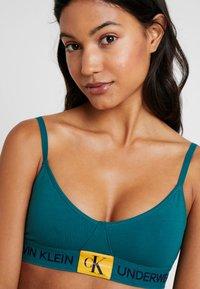 Calvin Klein Underwear - MONOGRAM UNLINED TRIANGLE - Bustier - dark green/orange - 4