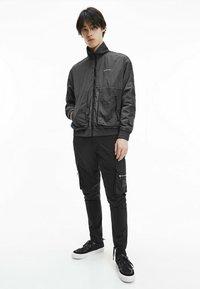 Calvin Klein Jeans - Windbreaker - black - 1