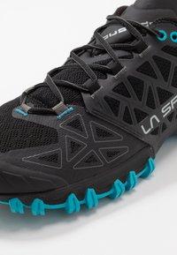 La Sportiva - BUSHIDO II - Trail running shoes - black/tropic blue - 5