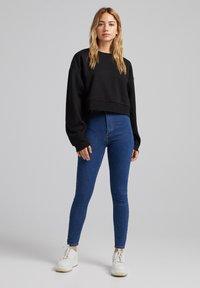 Bershka - SUPER HIGH WAIST - Slim fit jeans - dark blue - 1