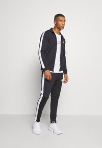Under Armour - EMEA TRACK SUIT - Survêtement - black - 1
